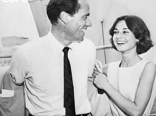 16 Jun 1957, New York, New York, USA --- Actress Audrey Hepburn helps her husband Mel Ferrer doff his jacket aboard the S.S. on which they took leave of New York and its sizzling temperatures for a second honeymoon in Switzerland. The Ferrers spent their original honeymoon in Switzerland in 1954. --- Image by © Bettmann/CORBIS