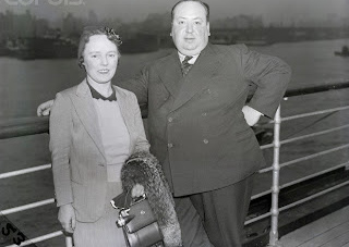 New York, New York, USA --- 6/6/1938- New York, NY: Alfred Hitchcock, England's foremost film director is shown with his wife as they arrived aboard the SS Queen Mary. Hitchcock plans to make his first visit to Hollywood. --- Image by © Bettmann/CORBIS